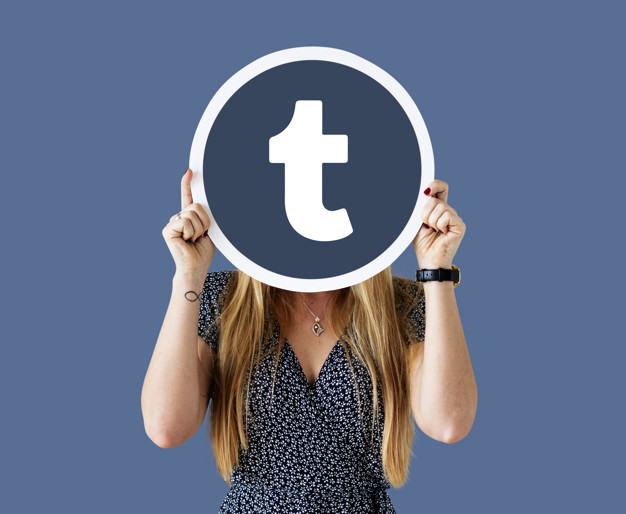 Woman showing a Tumblr icon